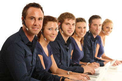 people in a call center helping customers